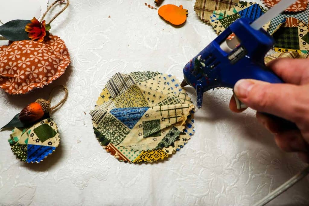 hot glueing no sew sukkah ornaments together